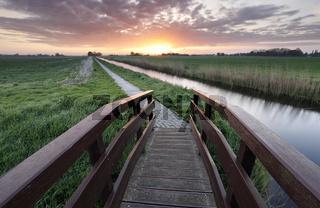 sunrise over cycling path and bridge
