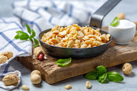 Delicious salted peanuts in a frying pan.