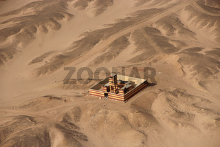 Aerial view with alone building in desert