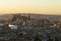 Edinburgh Castle skyline in golden light seen from Arthur's Seat