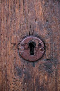 Security lock for an old wooden door in the garden