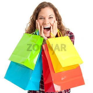 Young woman with her colorful bags is happy about shopping discounts isolated on white background
