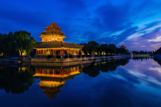 Beijing, China - JUN 27, 2014: Sunset at Forbidden City Moat, Corner Towers