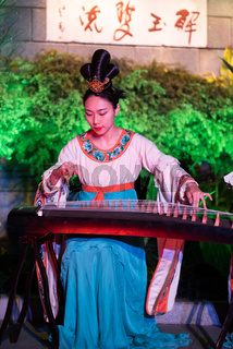 Traditional chinese female musicians and dancers