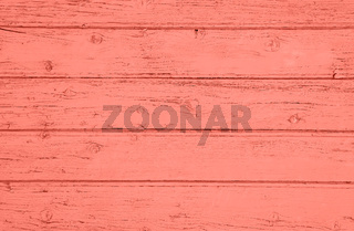 Coral pink toned vintage wooden planks background