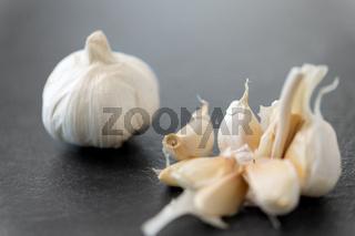 garlic on slate stone background