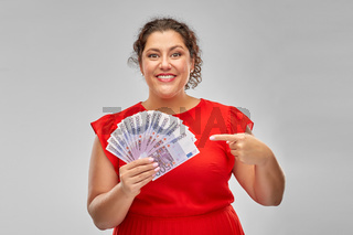 happy woman showing euro money banknotes