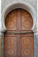 Old wooden doors in traditional Moroccan style.