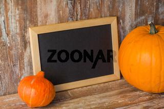 blank chalkboard and halloween pumpkins