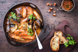 Traditional Catalan fish stew romesco de peix with prawns