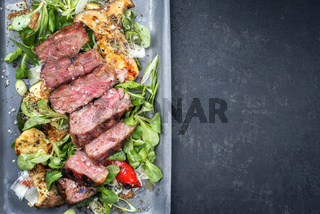Modern Style Italian tagliata di manzo with lamb salad dry aged sliced roast beef as top view in a skillet with copy space right