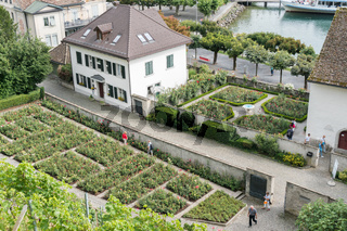 high angle view of the historic old town and rose gardens of Rapperswil with Lake Zurich behind