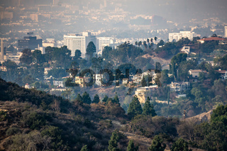 beverly hills and hollywood hills at sunset during woosley fires