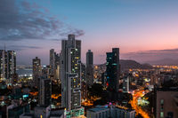 modern city skyline with sunset sky - skyscraper cityscape of Panama City