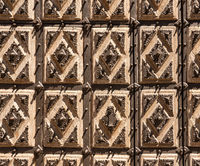 Detail of the solid door of the Convent of San Estaban in the old Salamanca in Spain