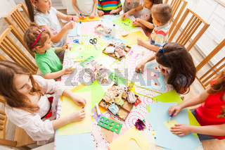 Children do postcards with their hands in a group