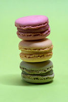 Macro shot of stack of macarons over green mint background