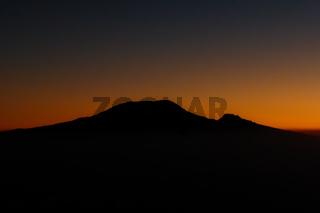 sunrise over the silhouette of Mount Kilimanjaro and Mawenzi in Tanzania