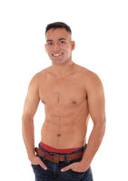 Shirtless man standing in jeans and smiling