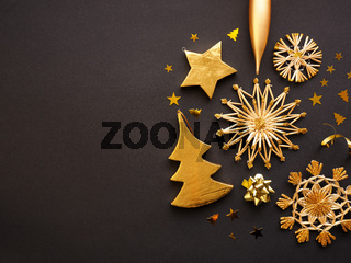 Golden Christmas decoration on a dark background, space for text