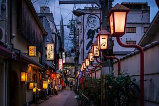Street light posts and restaurant lanterns in Osaka