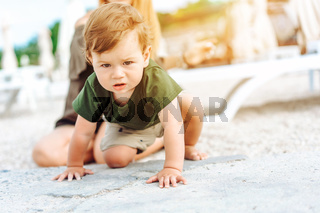 Little boy posing on camera, on vacation