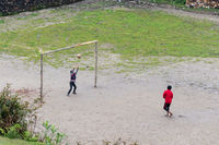 Children playing football in Ghalegaun, Nepal