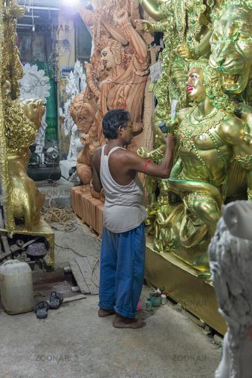 KUMARTULI, KOLKATA, INDIA, February 2012, Artisan working on completion of idol