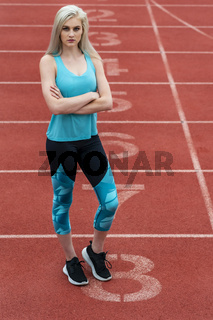 A Young Athletic College Athlete Prepares For A Track Meet At A University