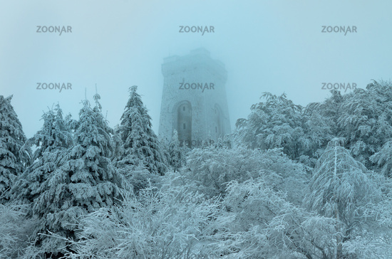 Memorial of Liberty Shipka, Gabrovo, Bulgaria - December 31, 2018 Winter picture, fog, deep snow, trees covered with snow, cold and frost. The Shipka Memorial is displayed in the mist between the pine trees - Shipka, Gabrovo, Bulgaria.