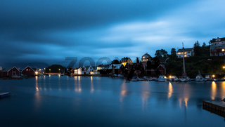 A wonderful Night shot of a city and harbor in Norway. beautiful landscape and light with sunset
