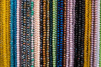 Hanged beads necklaces at a store.