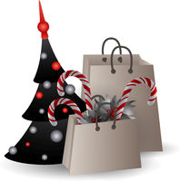 Festive composition with Christmas tree and gift bags with branches and candyes on a white background.