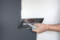 Plastering of a Concrete Wall