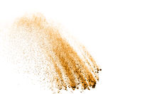 Freeze motion of brown dust explosion. Stopping the movement of brown powder. Explosive brown powder on white background.