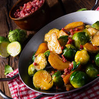 Brussels sprouts potato pan with bacon in rustic style