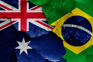 flags of Australia and Brazil painted on cracked wall