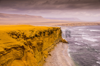 Yellow cliffs at Paracas National Reserve in Peru