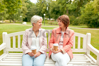 senior women or friends drinking coffee at park