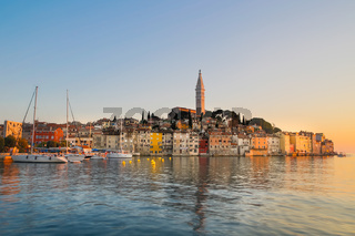 Colorful sunset of Rovinj town, Croatian fishing port on the west coast of the Istrian peninsula.