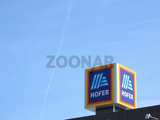 Hofer sign against blue sky. Aldi parent comapny
