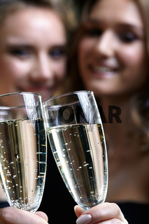 Two girls with glasses of champagne in their hands
