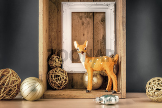 Christmas decoration wooden box with deer golden balls and a white frame