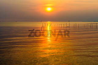 Colorful sunset at the tropical coast in Thailand