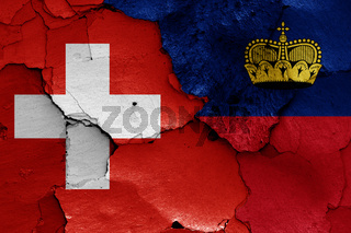 flags of Switzerland and Liechtenstein painted on cracked wall