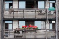 Chinese flags on an appartment balcony in downtown Chengdu