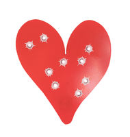 Bulletholes in a metal heart-shaped target
