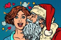Santa Claus kisses a woman, Christmas and New year