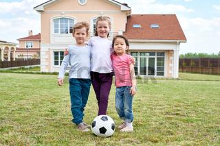 Three Kids Posing Outdoors