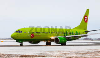 Boeing S7 Airlines taxis on a snowy runway